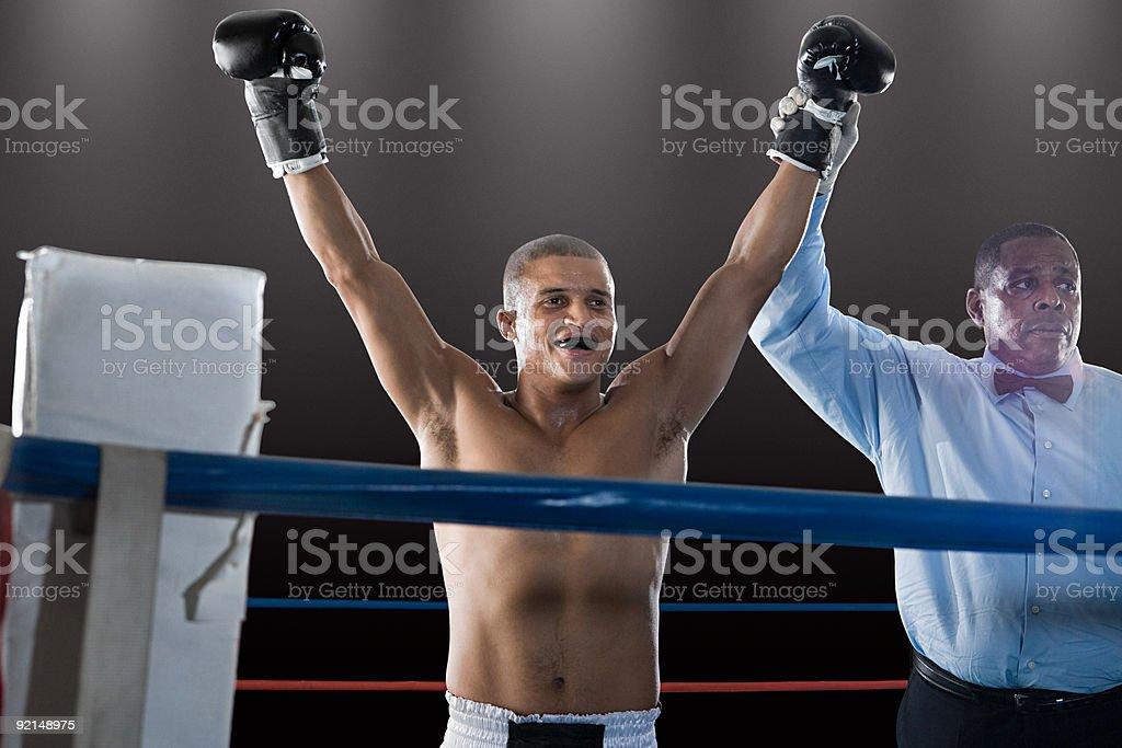 Winning boxer and referee stock photo