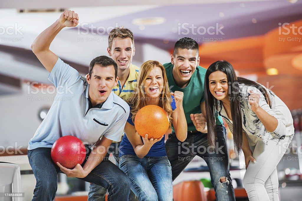Winning ecstatic bowling team. stock photo