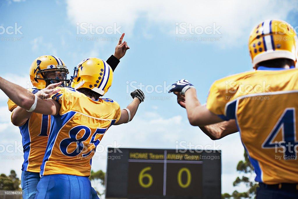 Winning football players cheering royalty-free stock photo