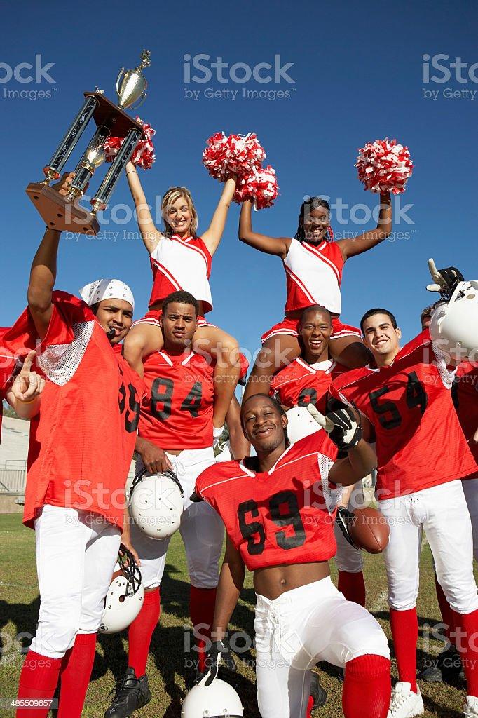 Winning Football Players with Cheerleaders stock photo