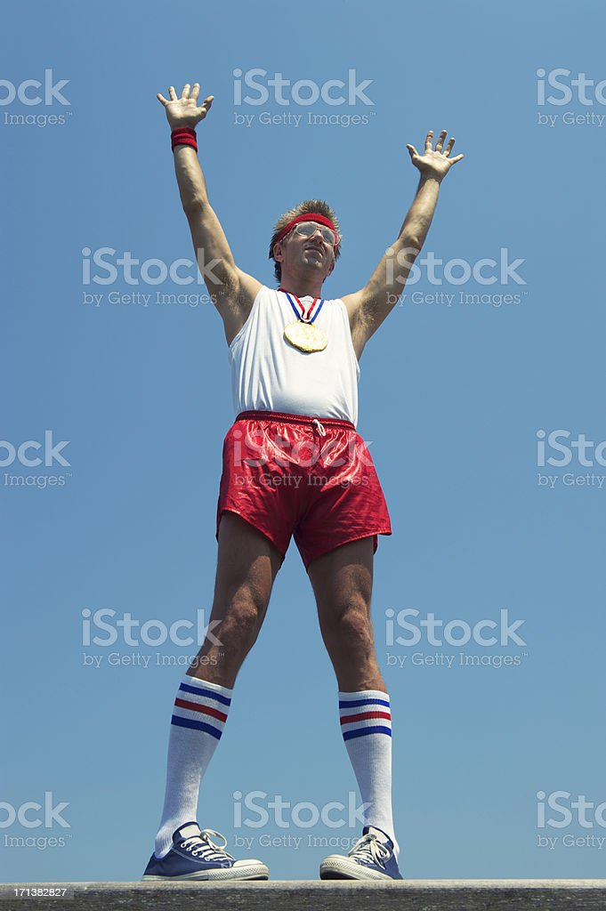 Winning Gold Medal Nerd Athlete Celebrates in Blue Sky royalty-free stock photo