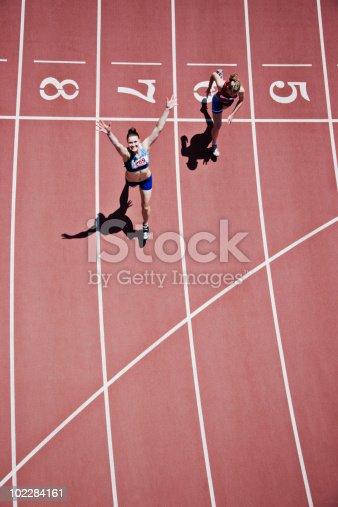istock Winning runner cheering on track 102284161