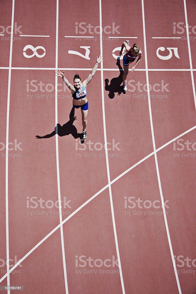 Winning runner cheering on track stock photo
