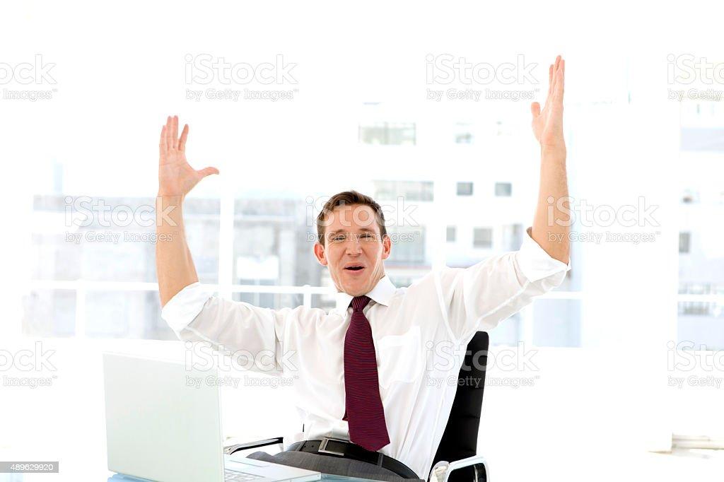 Winning Salesman at workplace stock photo