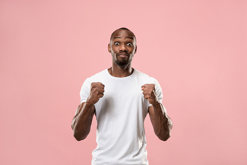 941370476 istock photo Winning success man happy ecstatic celebrating being a winner. Dynamic energetic image of male model 1005968278