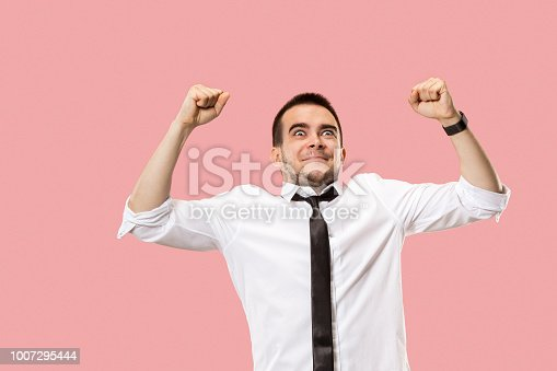 istock Winning success man happy ecstatic celebrating being a winner. Dynamic energetic image of male model 1007295444