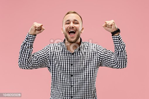 istock Winning success man happy ecstatic celebrating being a winner. Dynamic energetic image of male model 1049202028