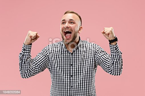 istock Winning success man happy ecstatic celebrating being a winner. Dynamic energetic image of male model 1049202034