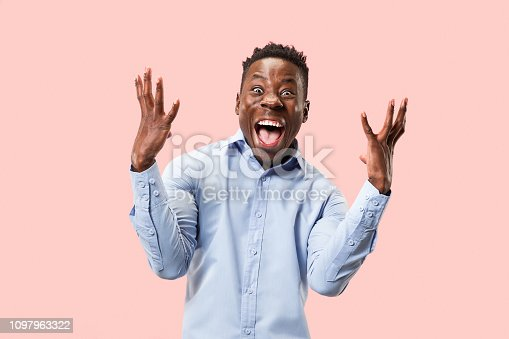 613525808 istock photo Winning success man happy ecstatic celebrating being a winner. Dynamic energetic image of male model 1097963322