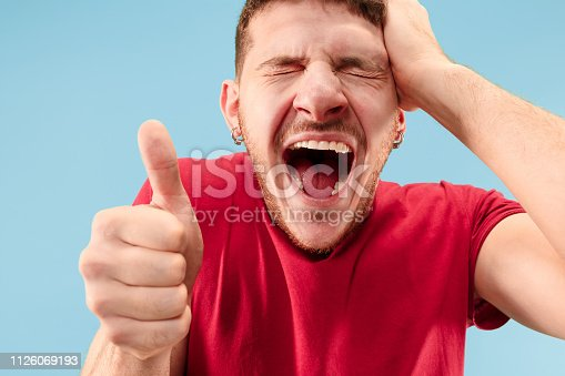 istock Winning success man happy ecstatic celebrating being a winner. Dynamic energetic image of male model 1126069193