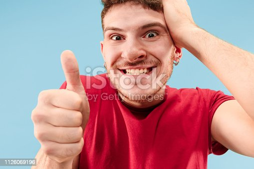 istock Winning success man happy ecstatic celebrating being a winner. Dynamic energetic image of male model 1126069196