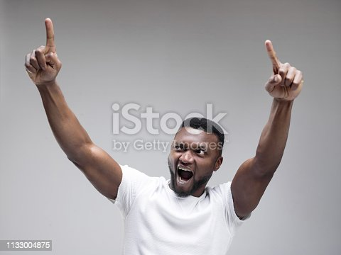 613525808 istock photo Winning success man happy ecstatic celebrating being a winner. Dynamic energetic image of male model 1133004875