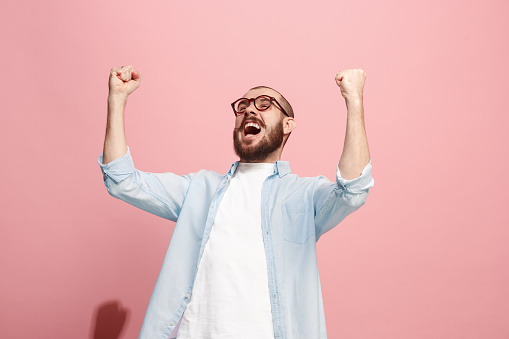 941370476 istock photo Winning success man happy ecstatic celebrating being a winner. Dynamic energetic image of male model 922783614
