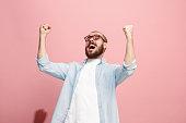 istock Winning success man happy ecstatic celebrating being a winner. Dynamic energetic image of male model 922783614