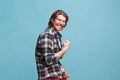 istock Winning success man happy ecstatic celebrating being a winner. Dynamic energetic image of male model 923744714