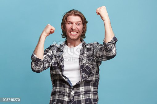 istock Winning success man happy ecstatic celebrating being a winner. Dynamic energetic image of male model 923749270
