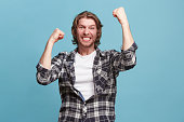 istock Winning success man happy ecstatic celebrating being a winner. Dynamic energetic image of male model 923749270