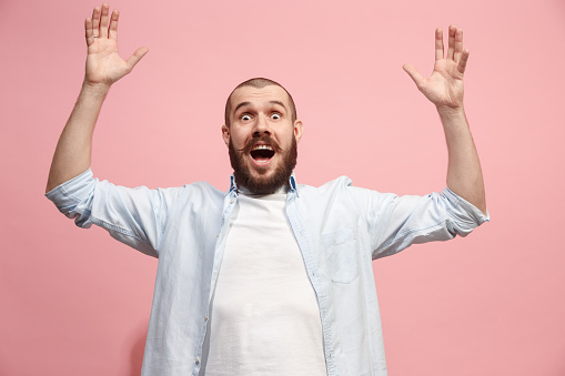 941370476 istock photo Winning success man happy ecstatic celebrating being a winner. Dynamic energetic image of male model 925622802