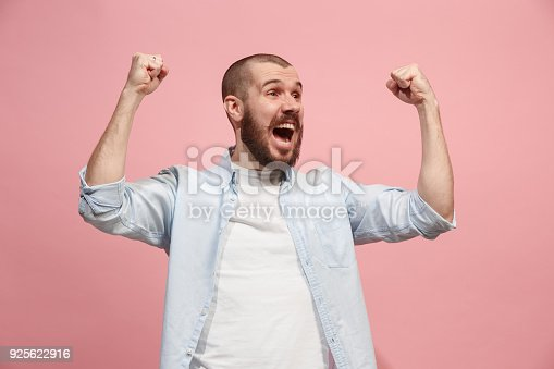 istock Winning success man happy ecstatic celebrating being a winner. Dynamic energetic image of male model 925622916