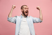 istock Winning success man happy ecstatic celebrating being a winner. Dynamic energetic image of male model 925622916