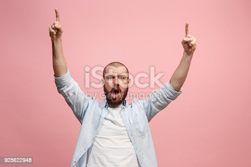 istock Winning success man happy ecstatic celebrating being a winner. Dynamic energetic image of male model 925622948