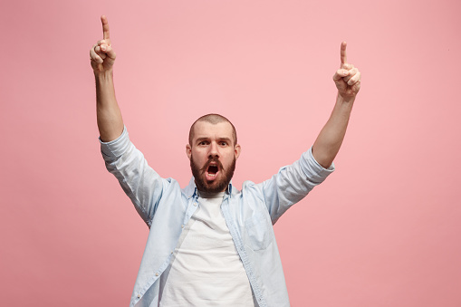 941370476 istock photo Winning success man happy ecstatic celebrating being a winner. Dynamic energetic image of male model 925622948