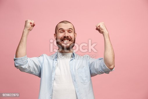 istock Winning success man happy ecstatic celebrating being a winner. Dynamic energetic image of male model 925622970