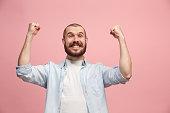 istock Winning success man happy ecstatic celebrating being a winner. Dynamic energetic image of male model 925622970