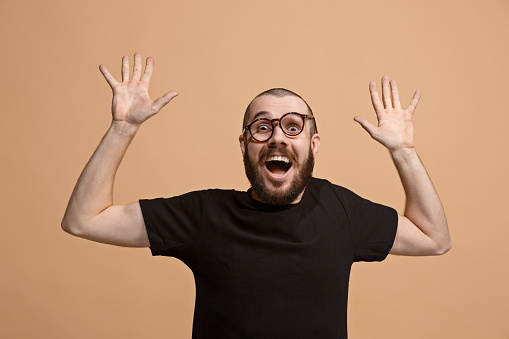 941370476 istock photo Winning success man happy ecstatic celebrating being a winner. Dynamic energetic image of male model 925631084