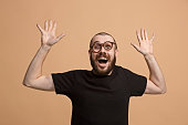 istock Winning success man happy ecstatic celebrating being a winner. Dynamic energetic image of male model 925631084