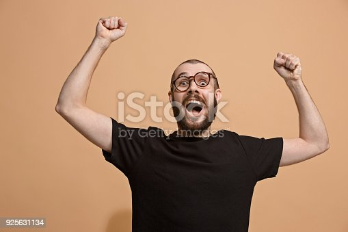 941370476 istock photo Winning success man happy ecstatic celebrating being a winner. Dynamic energetic image of male model 925631134