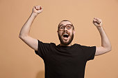 istock Winning success man happy ecstatic celebrating being a winner. Dynamic energetic image of male model 925631134