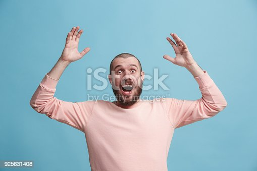 istock Winning success man happy ecstatic celebrating being a winner. Dynamic energetic image of male model 925631408