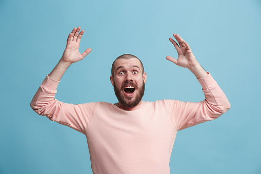 941370476 istock photo Winning success man happy ecstatic celebrating being a winner. Dynamic energetic image of male model 925631408
