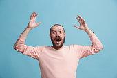 istock Winning success man happy ecstatic celebrating being a winner. Dynamic energetic image of male model 925631408