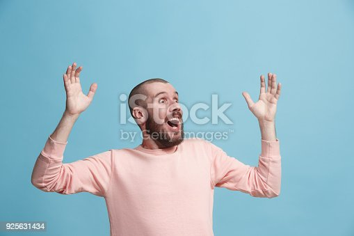 941370476 istock photo Winning success man happy ecstatic celebrating being a winner. Dynamic energetic image of male model 925631434