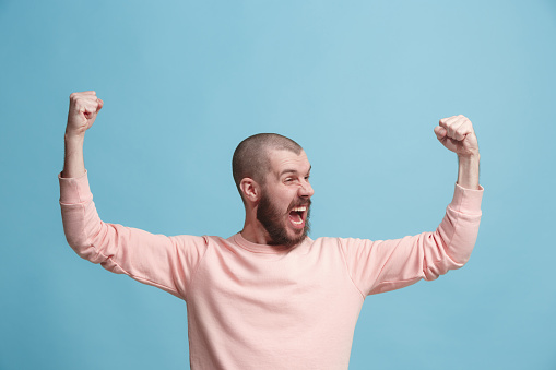 941370476 istock photo Winning success man happy ecstatic celebrating being a winner. Dynamic energetic image of male model 925631714
