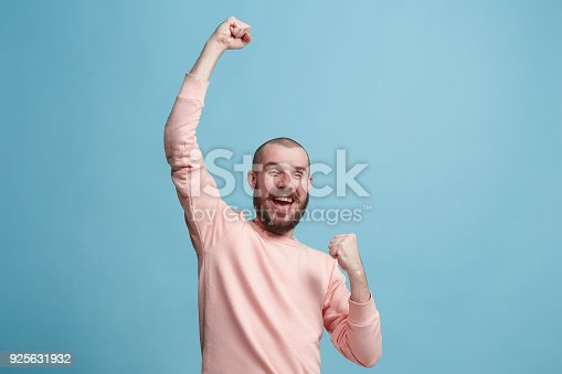istock Winning success man happy ecstatic celebrating being a winner. Dynamic energetic image of male model 925631932