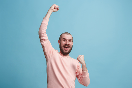 941370476 istock photo Winning success man happy ecstatic celebrating being a winner. Dynamic energetic image of male model 925631932