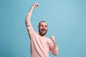 istock Winning success man happy ecstatic celebrating being a winner. Dynamic energetic image of male model 925631932