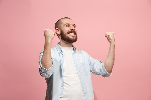 941370476 istock photo Winning success man happy ecstatic celebrating being a winner. Dynamic energetic image of male model 925632000