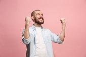 istock Winning success man happy ecstatic celebrating being a winner. Dynamic energetic image of male model 925632000