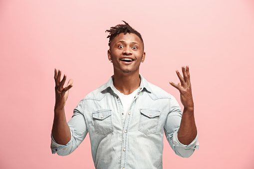 941370476 istock photo Winning success man happy ecstatic celebrating being a winner. Dynamic energetic image of male model 927045950