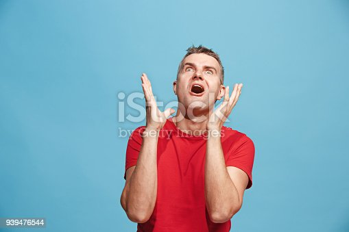 istock Winning success man happy ecstatic celebrating being a winner. Dynamic energetic image of male model 939476544