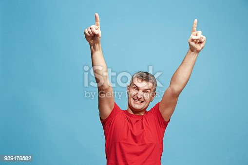 istock Winning success man happy ecstatic celebrating being a winner. Dynamic energetic image of male model 939476582