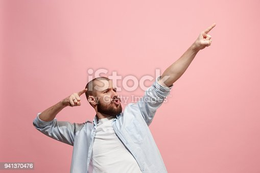 istock Winning success man happy ecstatic celebrating being a winner. Dynamic energetic image of male model 941370476