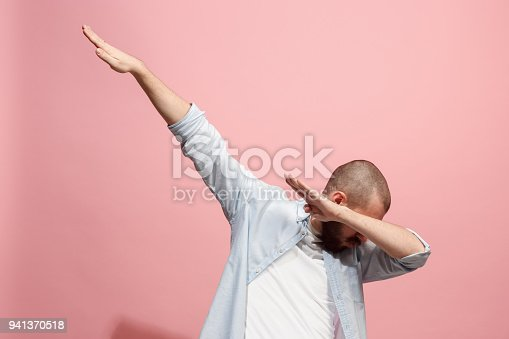 istock Winning success man happy ecstatic celebrating being a winner. Dynamic energetic image of male model 941370518