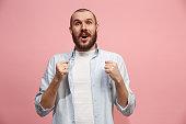istock Winning success man happy ecstatic celebrating being a winner. Dynamic energetic image of male model 941371912