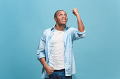 istock Winning success man happy ecstatic celebrating being a winner. Dynamic energetic image of male model 942967120