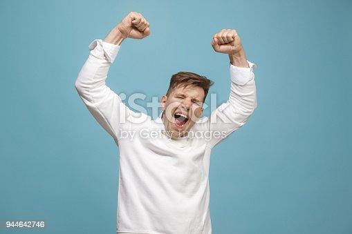 istock Winning success man happy ecstatic celebrating being a winner. Dynamic energetic image of male model 944642746